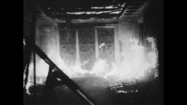 fire destroys architectural landmarks and art collection at the bourse stock exchange in vienna, austria / firefighters carrying paintings out of the... - arte dell'antichità video stock e b–roll