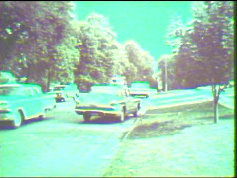 fire engine driving down residential street - feuerwehr hinweisschild stock-videos und b-roll-filmmaterial