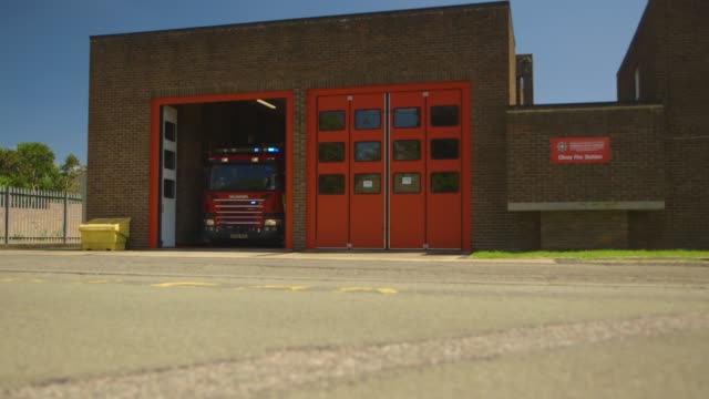 fire engine leaving the fire station with lights flashing - fire station stock videos & royalty-free footage