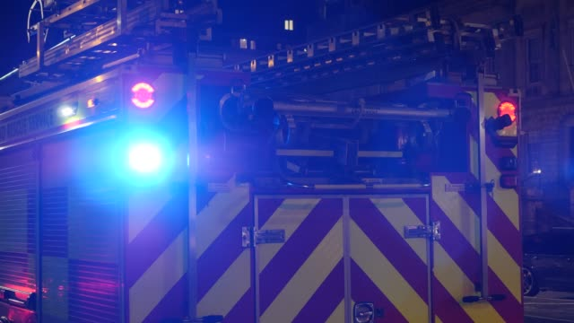 4k: fire engine with blue flashing lights - fire truck stock videos and b-roll footage