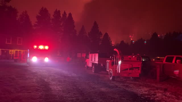 fire engine with emergency lights on as caldor fire burns near echo summit, ca, u.s., on monday, august 30, 2021. california's caldor fire moved... - californian sierra nevada stock videos & royalty-free footage