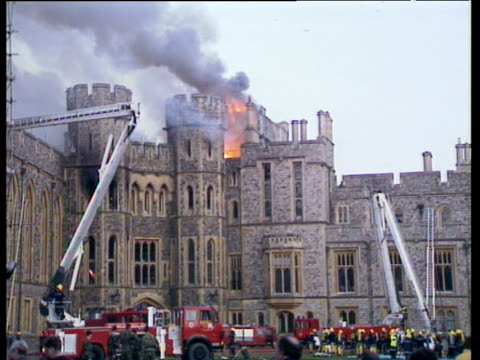 fire engines and firemen attempting to extinguish fire in windsor castle's brunswick tower windsor castle fire 20 nov 92 - berkshire england stock videos & royalty-free footage