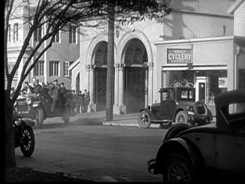 ms, b&w, fire engines, cops cars and ambulance driving on street, 1930's  - 無声映画点の映像素材/bロール