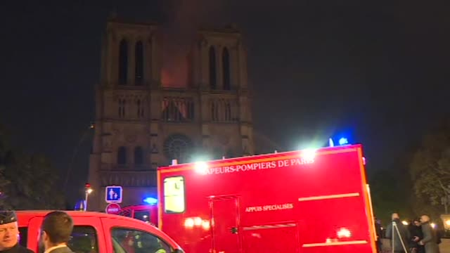 fire engines gather outside notre dame cathedral while an impressive fire is underway potentially linked to the renovation work on the building... - brigade stock videos and b-roll footage