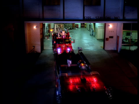 fire engines leave a fire station for an emergency. - fire engine stock videos & royalty-free footage