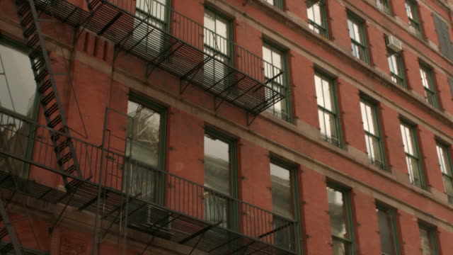 td fire escape outside of new york apartment building / new york, united states - fire escape stock videos and b-roll footage