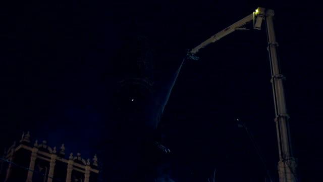 stockvideo's en b-roll-footage met fire extinguishment on a belfry at night - keukentrap