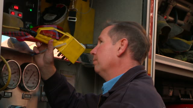 ms fire fighter checking equipment in fire truck/ richmond, virginia - western script stock videos & royalty-free footage