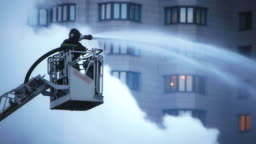 Fire fighter during intense fire extinguishment