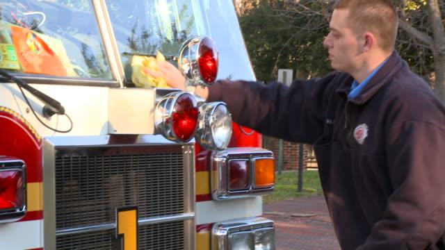 ms pan fire fighter polishing lights on fire truck/ richmond, virginia - polishing stock videos & royalty-free footage