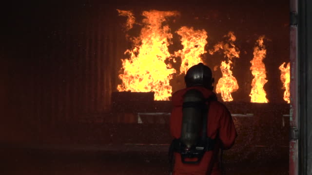 fire fighter practice slow motion - fire station stock videos & royalty-free footage