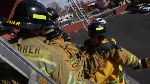 Fire Fighters run through a number of drills at the El Camino Community College Fire Academy in Inglewood California Fire Academy recruits carry an...
