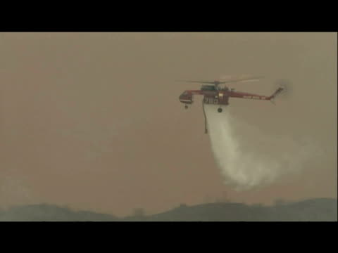 fire fighting helicopter drops water over forest fires 1 september 2009 - bbc stock videos & royalty-free footage