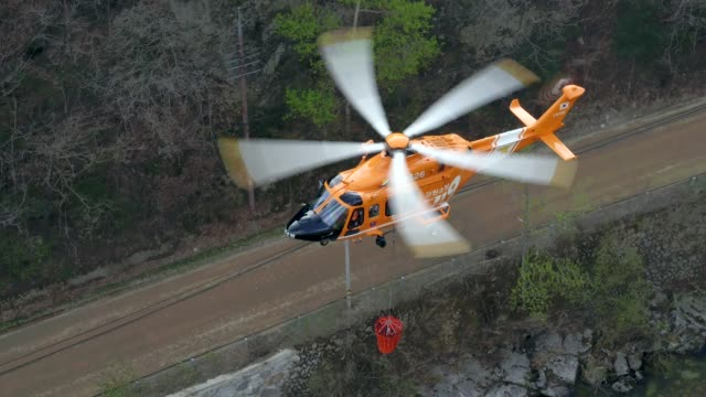 fire fighting helicopter flying for extinguishing forest fire at odaesan mountain / gangwon-do, south korea - bare tree stock videos & royalty-free footage