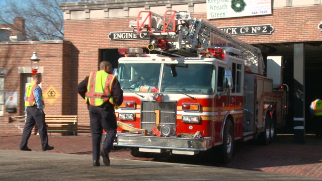 ws fire fire fighters watching street as truck reverses back into station garage/ richmond, virginia - fire station stock videos & royalty-free footage
