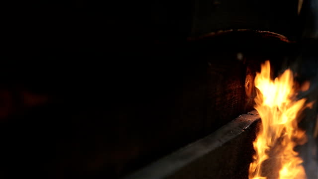fire flame burns a wooden surface. - wood grain stock videos and b-roll footage