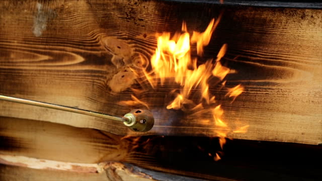 fire flame burns a wooden surface. - bunsen burner stock videos & royalty-free footage