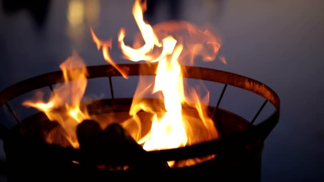 fire flames at night, burning wood fire in oil barrel - fireplace stock videos & royalty-free footage