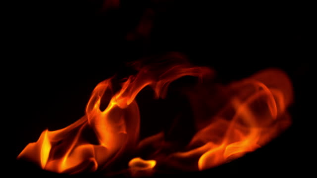 slo mo fire flames at night - flaming torch stock videos & royalty-free footage