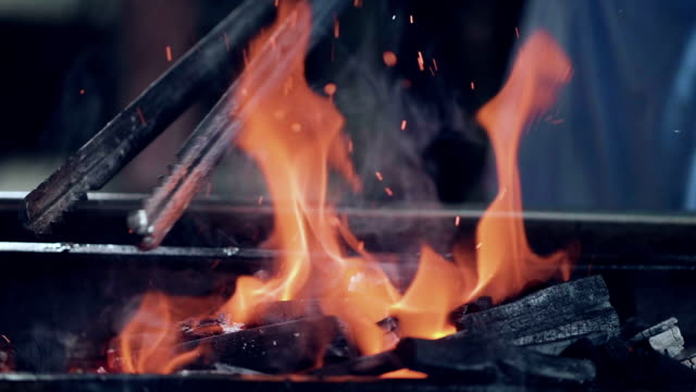 fire flames (slow motion) food street - punjab pakistan stock videos and b-roll footage