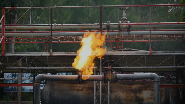 fire flames from gas pipe leak, fire extinguishers at industry factory - motor oil stock videos & royalty-free footage