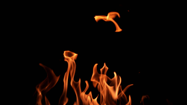 slo mo of fire flames on black background - flaming torch stock videos & royalty-free footage