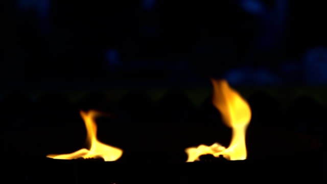 SLO MO of fire flames on black background