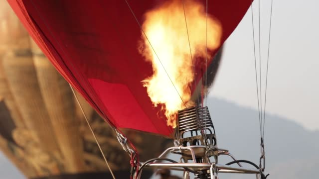 fire from gas jet burner in hot air balloon - hot air balloon stock videos & royalty-free footage