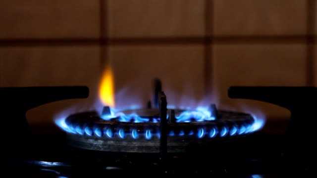 fire gas burning from a kitchen gas stove