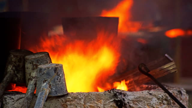 Fire in blast furnaces. Processing steel in iron foundry plant.