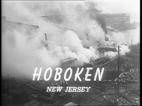 fire in hoboken / boats at hoboken pier dock with smoke / firefighters on pier 4 spray water on a war materials fire / victims are carried to safety... - victim stock videos & royalty-free footage