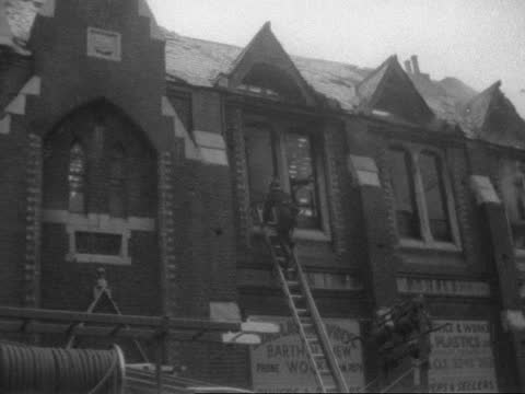 fire in plastics factory in islington; england: london: islington: ext bv people - tender & smoke in b/g fireman up ladder into building smoke l-r bv... - smoke physical structure stock videos & royalty-free footage