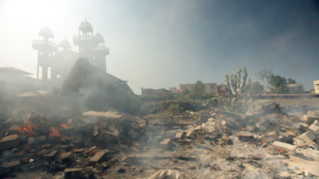 fire in the debris of the building caused by the haiti earthquake of january 2010 - ハイチ点の映像素材/bロール