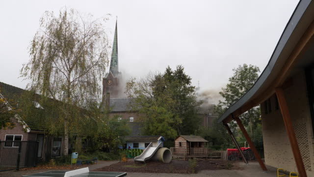 "fire in the roman catholic church of hoogmade on monday november 4 a fire started in the ""onze lieve vrouw geboortekerk"" during painting work the... - turmspitze stock-videos und b-roll-filmmaterial"