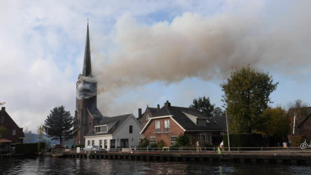 """fire in the roman catholic church of hoogmade. on monday, november 4 a fire started in the """"onze lieve vrouw geboortekerk"""" during painting work. the... - spire stock videos & royalty-free footage"""