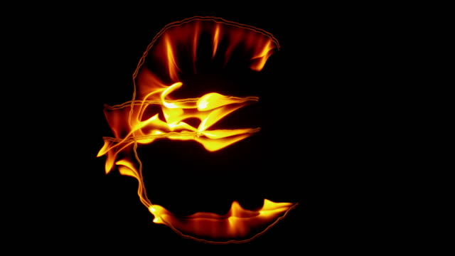 slo mo ld fire inscription of the euro symbol burning out on black background - euro symbol stock videos & royalty-free footage