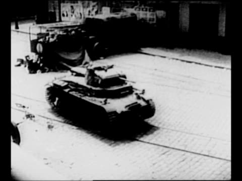 fire near parked cars and residential building in france / german tank drives on city street during world war ii / group of french soldiers with... - stationary stock videos & royalty-free footage