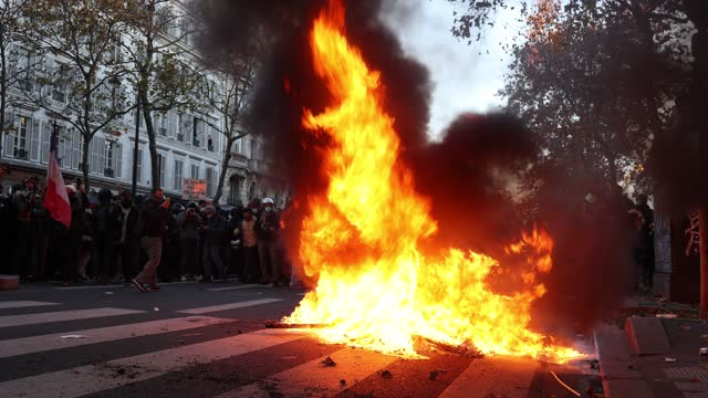 """fire occurs on a parisian boulevard while several overflows are in progress during the demonstration to protest against the """"global security"""" draft... - boulevard stock videos & royalty-free footage"""