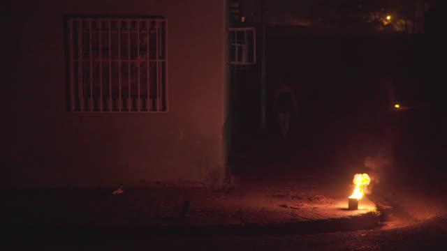 a fire on a street corner in puerto la cruz venezuela after a power cut - maduro stock videos & royalty-free footage