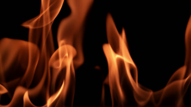 slo mo of fire on black background - flaming torch stock videos & royalty-free footage