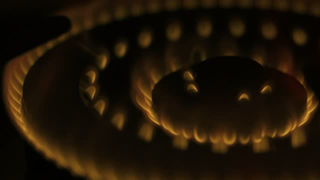 fire on gas stove  with dark background - yellow stock videos & royalty-free footage