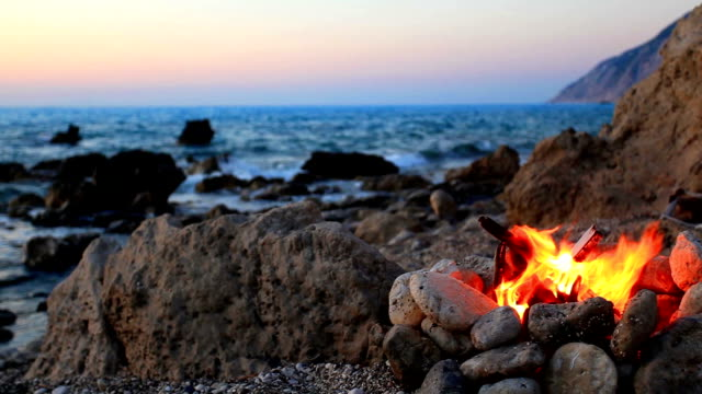 fire on the beach - camp fire stock videos and b-roll footage