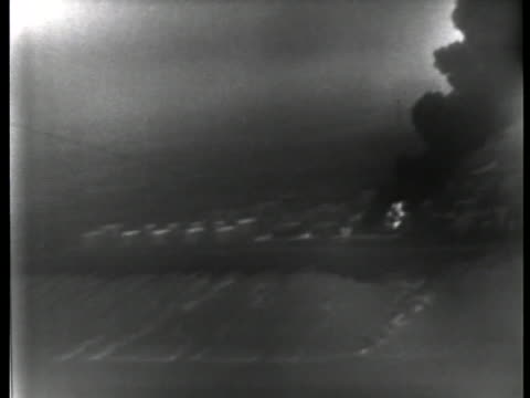 a fire rages out of control at a british oil depot in 1951 at the height of britain's crisis with iranian oil - 1951 stock videos & royalty-free footage