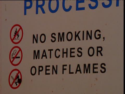 Fire risk warning sign at oil refinery, Barrow Island, Western Australia