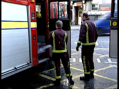 government and union trade insults; lib ext firefighters cleaning fire engines firefighters along to fire engine itn generics held server location... - オランダカイウユリ点の映像素材/bロール