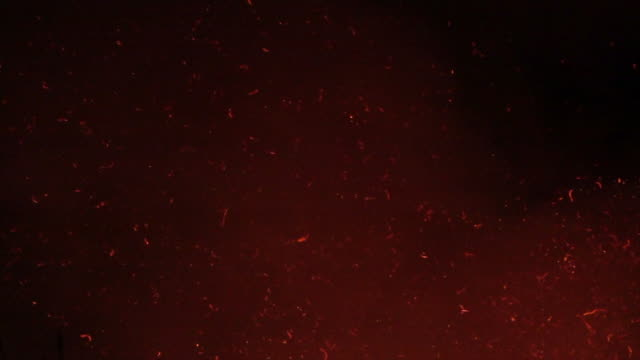 fire sparkle particle on night sky slow motion - cenere video stock e b–roll
