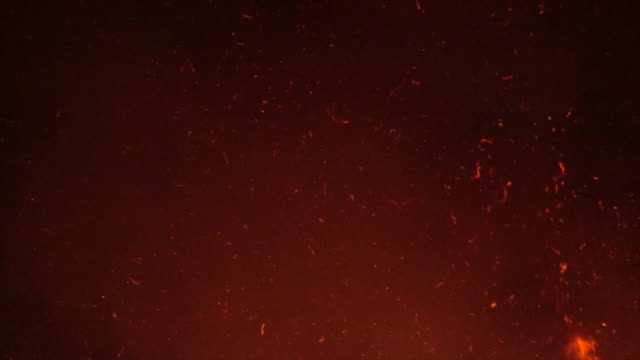 fire sparkle particle on night sky slow motion - summer heat stock videos & royalty-free footage