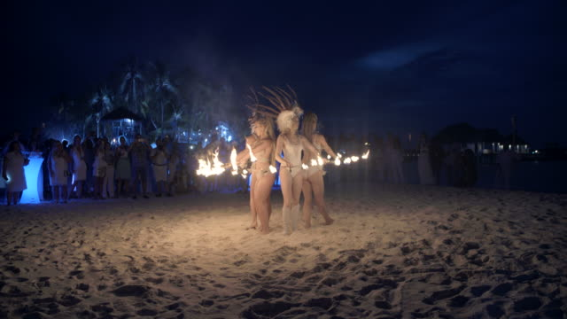 Fire spinners performing to a crowd / Hithadhoo, Maldives