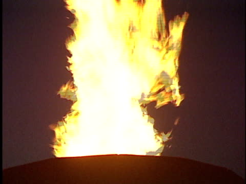 fire spiraling out of pillar dark all around except for flames hot flame red orange yellow light torch discovery life heat warmth roast cook passion... - column stock videos & royalty-free footage