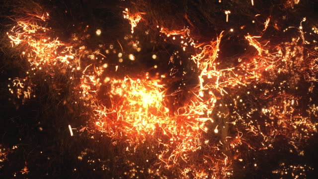 fire spreads rapidly through steel wool, a lot of sparks - fire natural phenomenon stock videos & royalty-free footage